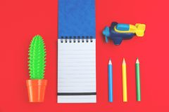 Colorful pencils, stationery, toy airplane on red stock photo