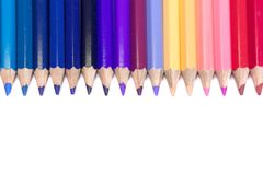 Colorful Pencils in Straight Line on Pure White Background Royalty Free Stock Photos