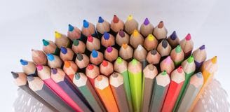 Colorful pencils in a vase. On a white background Stock Photo