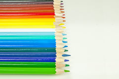 Colorful pencils on white desk - creative background Royalty Free Stock Photos