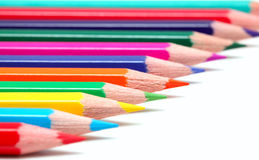 Colorful pencils on white surface Stock Photo