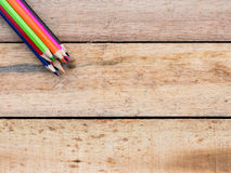 Colorful pencils on wood Stock Photo