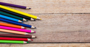 Colorful pencils on wood Royalty Free Stock Photos