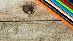 Colorful pencils on wood Stock Image