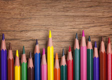 Colorful pencils. On a wooden background stock photos