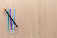 Colorful pencils on wooden background. Royalty Free Stock Images