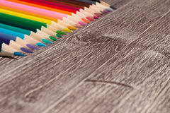 Colorful Pencils On Wooden Background royalty free stock photography