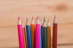 Colorful pencils. Wooden colorful pencils, on wooden table stock photography