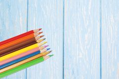 Colorful pencils on the wooden table. View from above stock photography