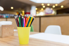 Colorful pencils in yellow glass closeup Royalty Free Stock Photos