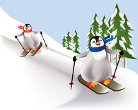 Colorful penguins skiing down a tree lined slope Royalty Free Stock Photos