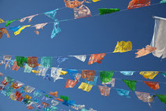 Colorful Pennants Blowing in Breeze. Ten strings of colorful pennants flapping in the breeze in Cozumel, Mexico, marketplace.  Deep blue sky in background Royalty Free Stock Photos