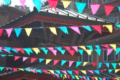 Colorful Pennants and Hindu Temple Roof. Colorful pennants and a Hindu temple roof in the city of Patan near Kathmandu, Nepal royalty free stock image