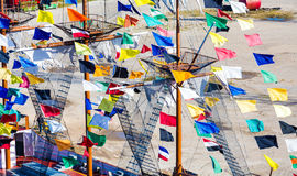 Colorful Pennants on Ship Masts Stock Photo