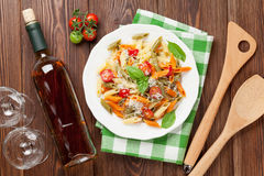 Colorful penne pasta and white wine Stock Photography