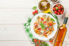 Colorful penne pasta and white wine Royalty Free Stock Photos