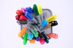 Colorful pens in a basket. Put on white background. yellow,green,blue,red royalty free stock images