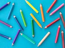 Colorful pens on blue Royalty Free Stock Images