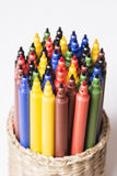 Colorful pens. In a box on a light background stock photography