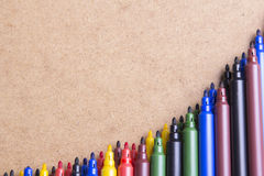 Colorful pens. On brown background stock photos