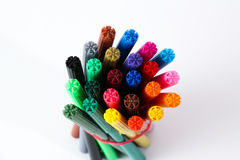 Colorful Pens. A bunch of colorful pens against white background, showing only the tips Stock Image