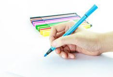 Colorful pens with hand holding Stock Photos