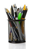 Colorful pens in holder isolated on white Stock Photo