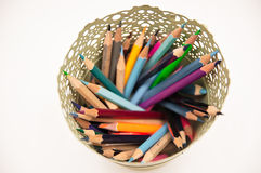 Colorful pens and pencils in vase isolated on white background Royalty Free Stock Photos