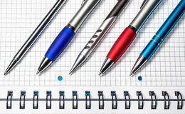 Colorful pens. Pens on the notebook. Colorful advertising pens. Writing notes royalty free stock photos