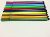 Colorful pens. Red green blue yellow pink violet brown black gold Stock Photos