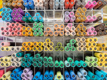 Colorful pens on shelf in stationery store, selective focus. A shelf of colorful pens royalty free stock photos