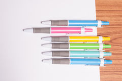 Colorful pens on the white paper. On white background Stock Photos
