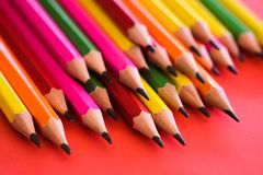 Pencil on red background. stock photos