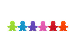 Colorful people figures standing in a row Stock Photos