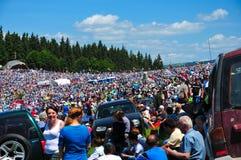 Colorful people, pilgrims around the world on Catholic pentecostal Stock Photos