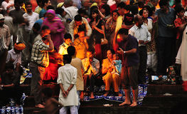 Colorful People and Priest Worship/Offer Puja, Haridwar, India Stock Photo