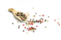 Colorful pepper. A wooden spoon with colorful pepper is isolated Stock Images