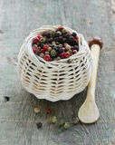 Colorful peppercorn in wicker bowl Royalty Free Stock Image