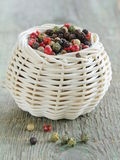 Colorful peppercorn in wicker bowl Royalty Free Stock Photography