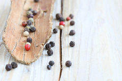Colorful peppercorns. Colourful peppercorns with tomato and basil stock photography