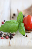 Colorful peppercorns. Colourful peppercorns with tomato and basil stock images
