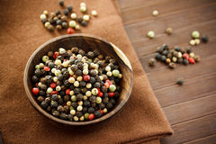 Colorful peppercorns in wooden bowl Stock Images
