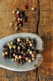 Colorful Peppercorns on a Wooden Spoon Royalty Free Stock Photo