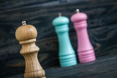 Colrful Peppermills on Blue Wooden Background Royalty Free Stock Photography