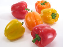 Colorful Peppers 3. Scattered red, gold, and yellow bell peppers on a white background stock photography
