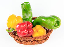 Colorful peppers in a basket Stock Photography
