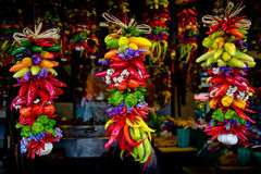 Colorful peppers and garlics hanging at market Royalty Free Stock Image