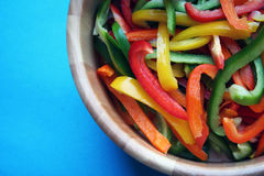 Colorful Peppers Green Red orange and Yellow in wooden bowl Royalty Free Stock Photography