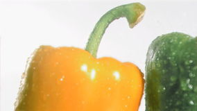 Colorful peppers in super slow motion receiving drops Stock Image