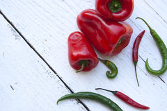 Colorful peppers on white wooden table Royalty Free Stock Image